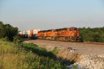 3 Orange Gevo's rock a stack train down the Transcon into the Evening Sun,