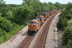 BNSF 5418 and 8 other unit's roll lite power west to KC.