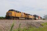 UP 8209 Leads a stack train west toward La Plata Mo.