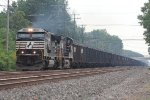An NS SD60E and a GE lead a loaded coal train eastbound into town