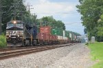 NS 9221 leads a heritage unit(N&W) eastbound through town on an intermodal