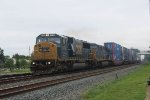 Ex Con SD60I 8738 leads Q113 west on an overcast and damp day