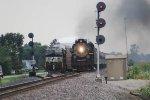 Running around an auto rack train as the train rolls past the Wabash interlocking signals