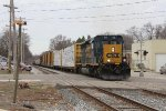 CSX 4035 climbs the hill eastward through town on Track 1 with D707