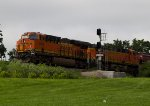 BNSF6964 pusshing a grain train by Peck Park