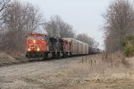 A few miles west of Schoolcraft, M395 rolls west at track speed on the South Bend Sub