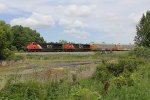 CN 2313 & 2587 roll north on the Holly Sub with M371