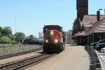 Westbound mixed freight #385 coming out of the sun
