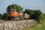 BNSF 5922 Heads up a empty Ucex coal drag.