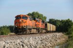 BNSF 6071 drags an empty North up the K line.