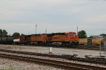BNSF 5784 Leads a loaded oil can Sb out of the Alton and Southern.