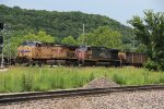 UP 5768 Leads a empty coal train west down the Jeff city Sub.