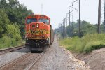 BNSF 9989 Get's ready to shove hard up hill into Mount Pleasant Iowa.