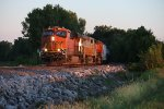 BNSF 6513 Leads a freight into the setting sun.
