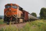 BNSF 7113 Dpu on a SB loaded oil can.
