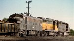 CR SD-35 6038 leads leased CNW GP-30 818 and F-7A 1729