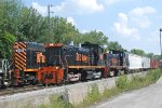 ABC 1501, and 1502 pass the parked stone train power.