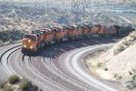 BNSF 7716 and six siblings hunker down as they approach the summit of Cajon Pass