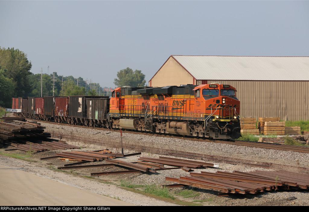 Ge's lead a empty tie train into Old Monroe Mo.