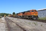 BNSF 7155 Sits dead with a Mow train in tow.