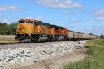 BNSF 9857 Drags a coal load down the K Line.