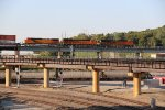BNSF 7049 Leads a Q train over the flyover.