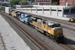 UP 8498 Screams past Kc Union Station with a stack train in tow.