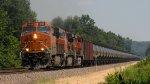 BNSF 8156 leads an oil train south at Dexter Missouri