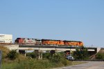 BNSF 8033, 6908, and 4711 plus a BNSF hi-railer boom truck