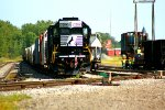 NS 3394 tied down in SK Yard with the End of Train Device on the engine and I also caught this crane and a covered hopper on a flatcar on the tracks