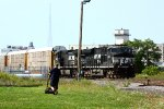 NS 8143 and, NS 9958 on the Howard Runner going by SK Yard while a guy cuts the grass
