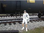 Standing by Tank Car