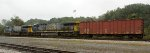 Rerailed CSXT 652 and sister unit 5014 and lead buffer car drift east from the derailment site to Sand Hook Yard in Lynchburg
