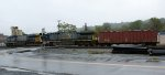 K125's locomotives and buffer car cross Concord Tpke.  Sandy Hook Yard office to the right