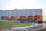 BNSF 3844, 3847,385O,3849,3851 pull out of GE Fort Worth Locomotive Plant with GE Test Crew at the Helm to take this 5 ET44C4'S  to BNSF Allance yard Texas.