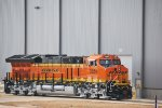 BNSF 3854 reverses off the Tranfer Dolly on thr Test Track alongside the Final Assembly Building.