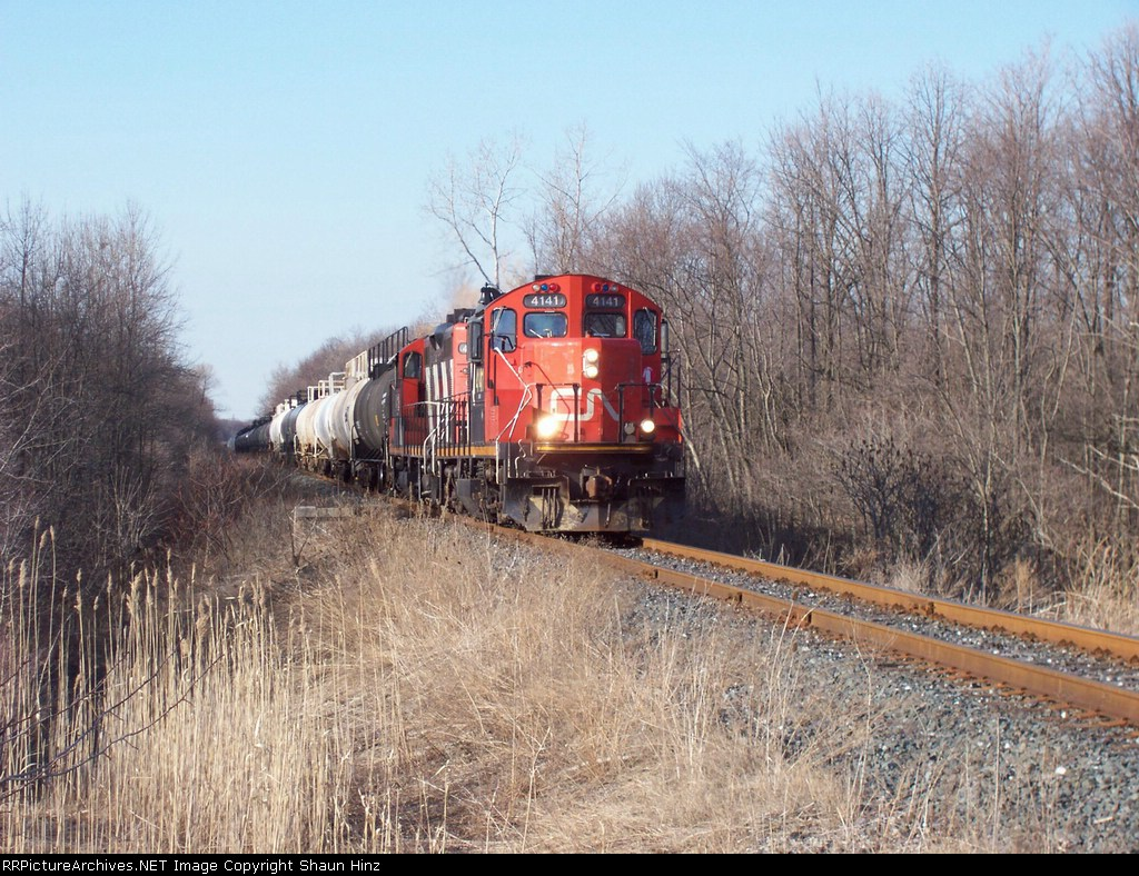 "CN 4141 aproches the Lassale road crossing with the local ""idustrial"""