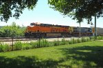 BNSF 7184 and CSX 13 eastbound at Trempealeau, WI_6-21-16