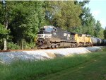 NS Dash9 leads a UP SD70M on 391