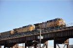 Coal loads roll east on the bridge
