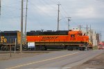 BNSF 1525 leads the light power across Winter Street
