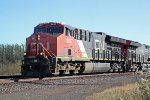 CN 3037 finally has the light and gets its northbound manifest rolling