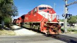 Two SD90MACs lead a mixed freight
