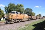 UP 6837 serves as the DPU on a loaded coal train