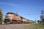 UP 7649 leads a westbound intermodal past the park