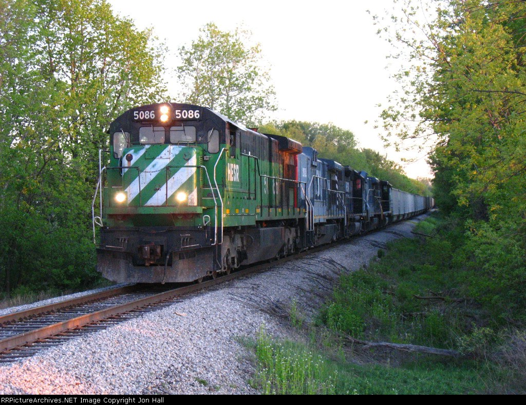 HESR 5086 leads its siblings north as they head out with a 771 coal train for Essexville