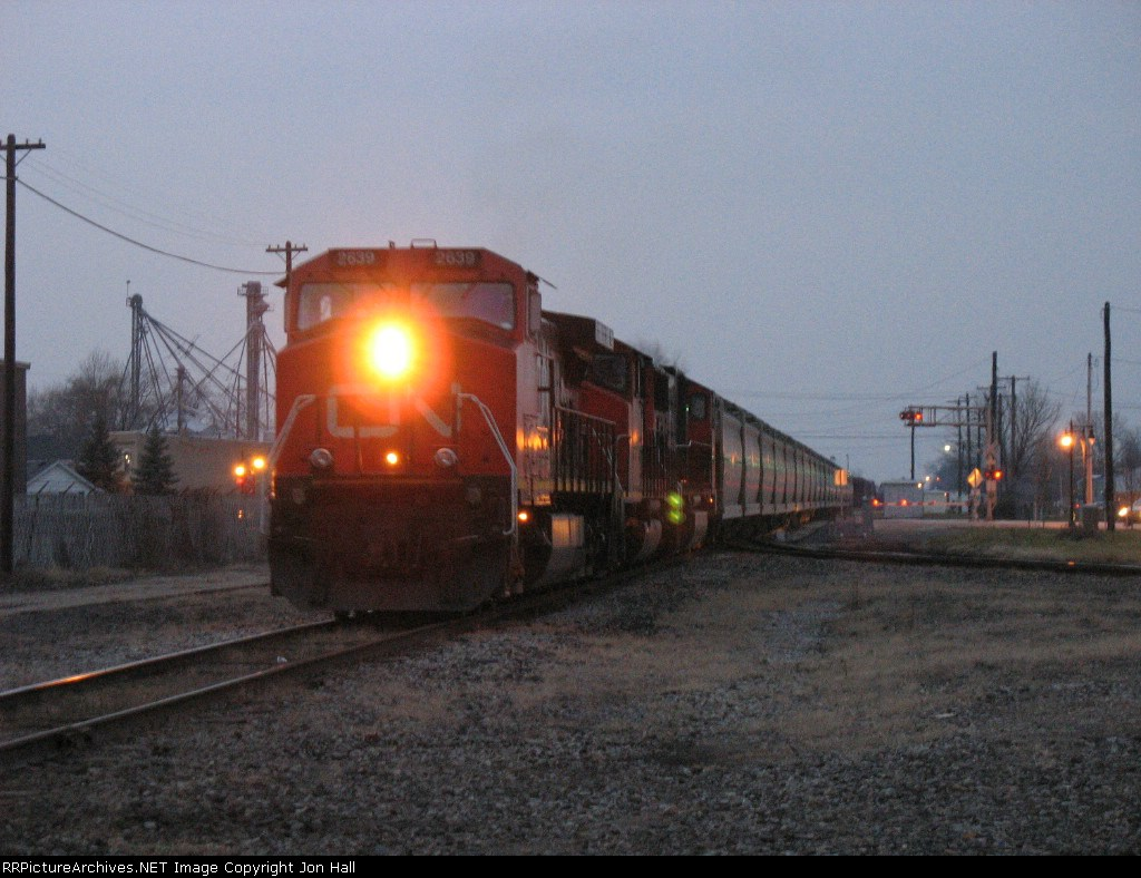 CN 2639, 5245 & 5779 backing a cut of cars into the yard