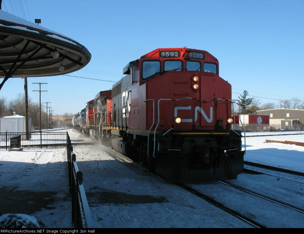 CN 9592, 2580 & GTW 5853 rolling past the station