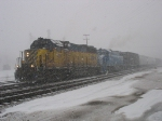 "TSBY 389 & GLC 385 pulling southward out of the yard while some ""light snow"" falls"