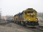 BNSF 6935 slowly brings M394 towards the station